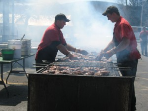 Brooks BBQ cooks working at fundraiser