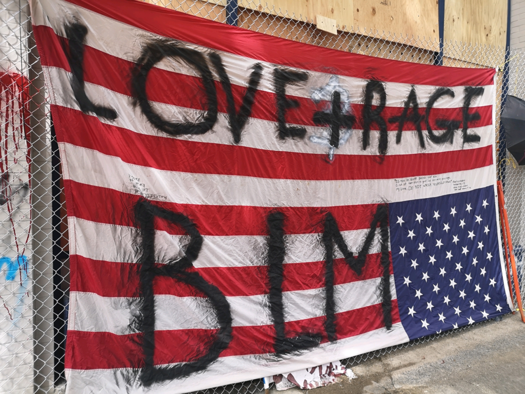 June 14, 2020 - BLM defaces Flag at Seattle CHAZ