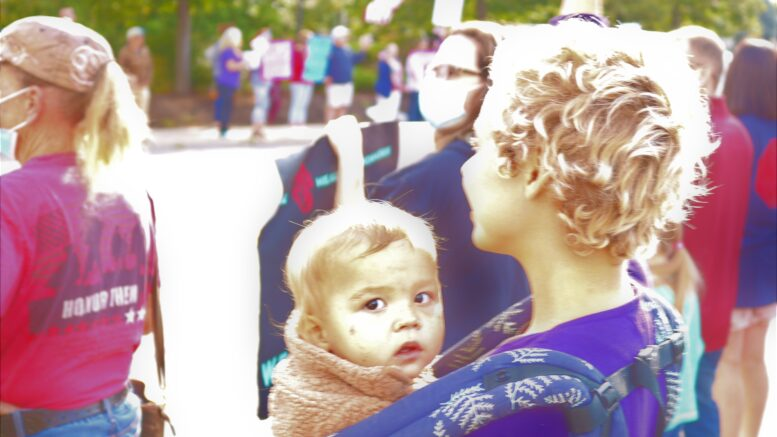 Mother and child at vaccine mandate protest in New York